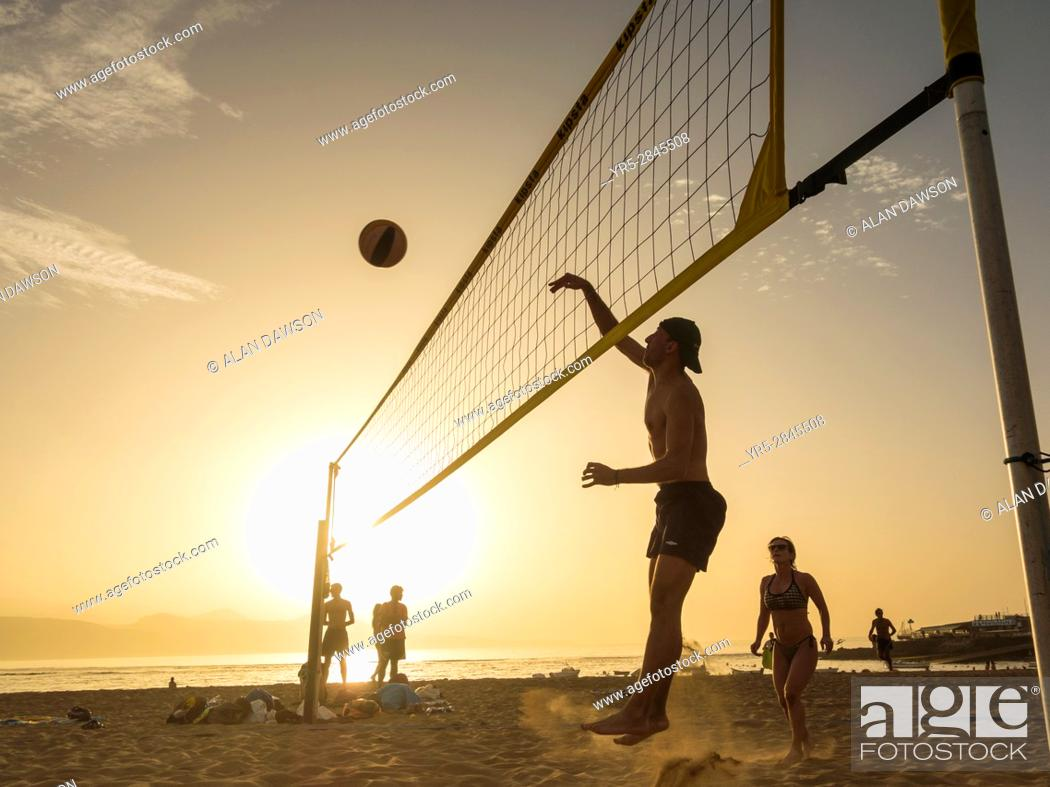 Stock Photo: Beach volleyball at sunset on Las Canteras beach in Las Palmas, Gran Canaria, Canary Islands, Spain.