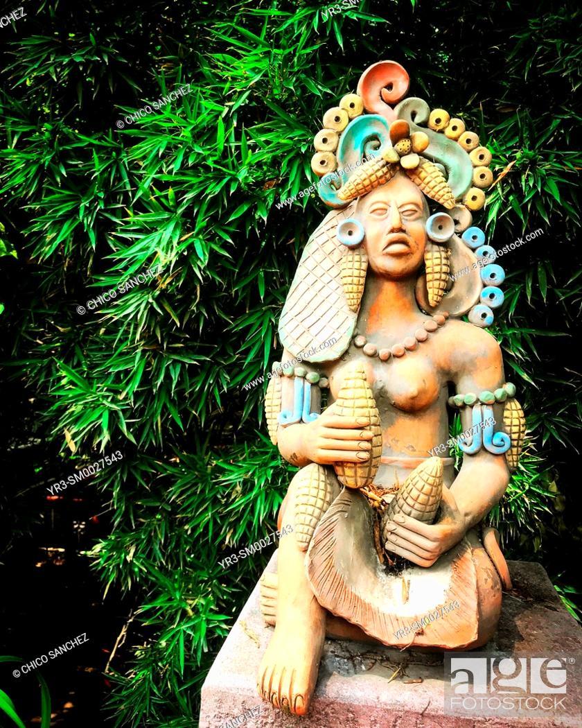 Stock Photo: A Mayan sculture holding corn cobs decorates the patio of Hacienda de Cortes, Coyoacan, Mexico City, Mexico, Mesoamerican, Mexican.