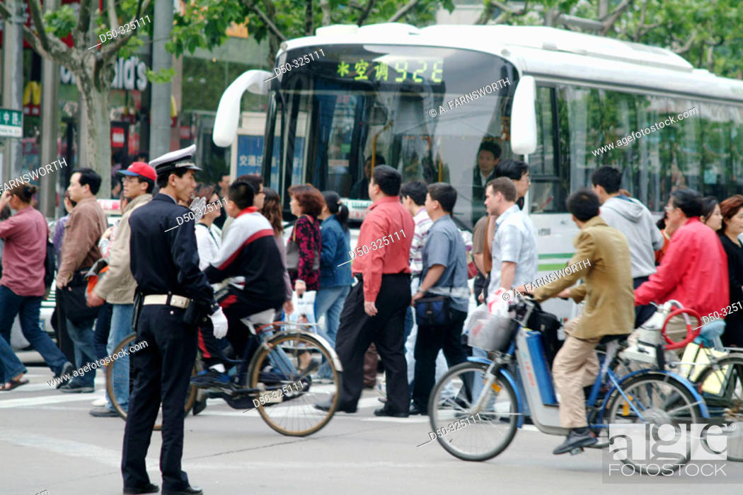 Stock Photo: Police, pedestrians and bus. Shanghai. China.