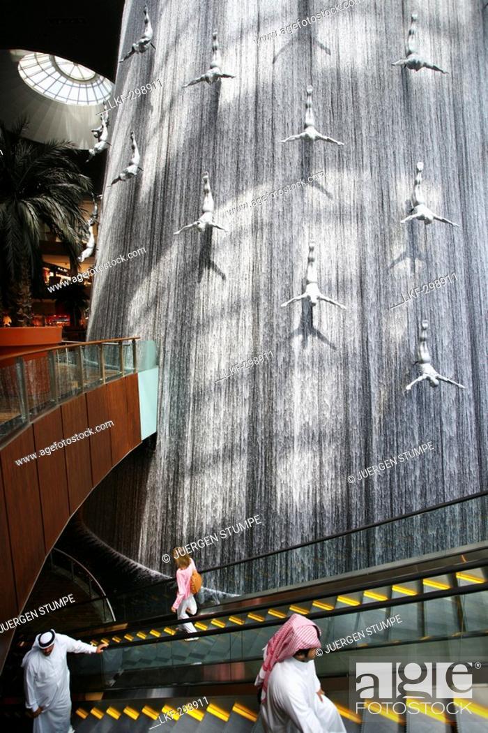 Giant waterfall with sculptures inside Dubai Shopping Mall, Dubai