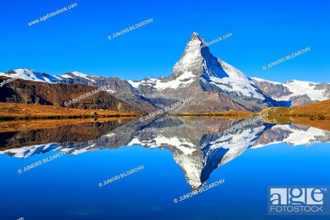 Stock Photo: The Matterhorn (4478 m) mirrored in mountain lake (Stellisee). Zermatt, Valais, Switzerland.