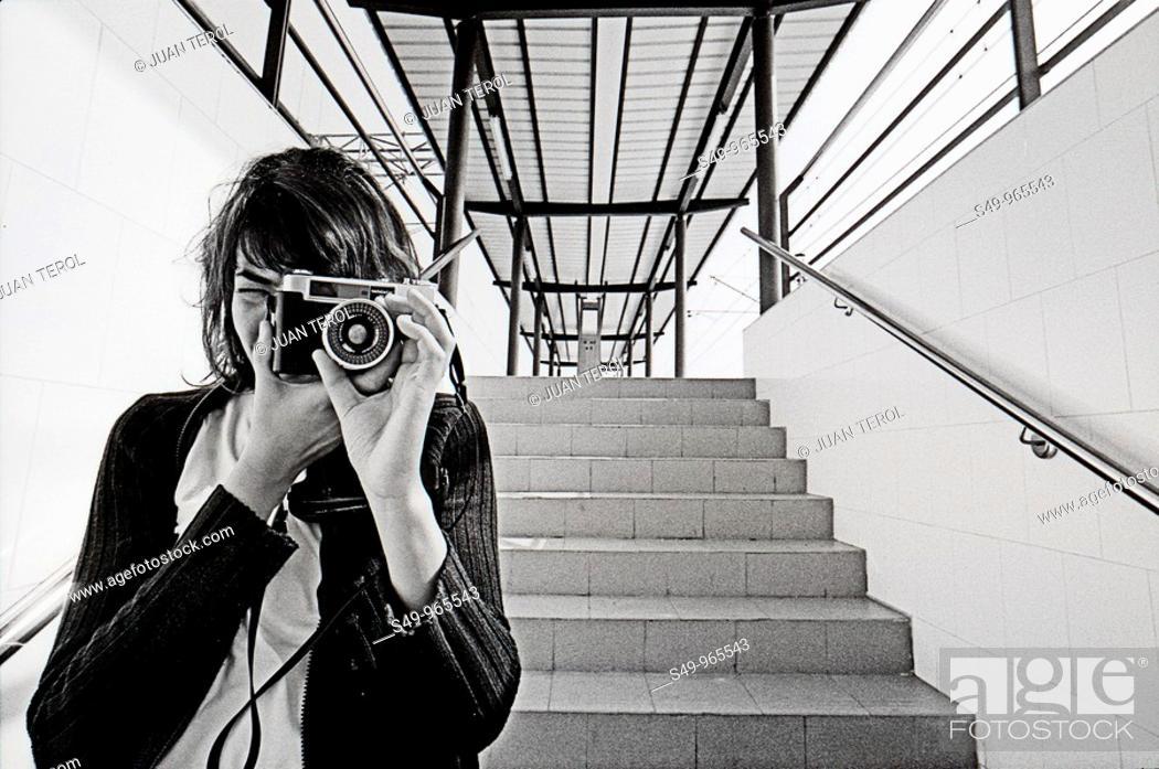 Stock Photo: woman making a photo.