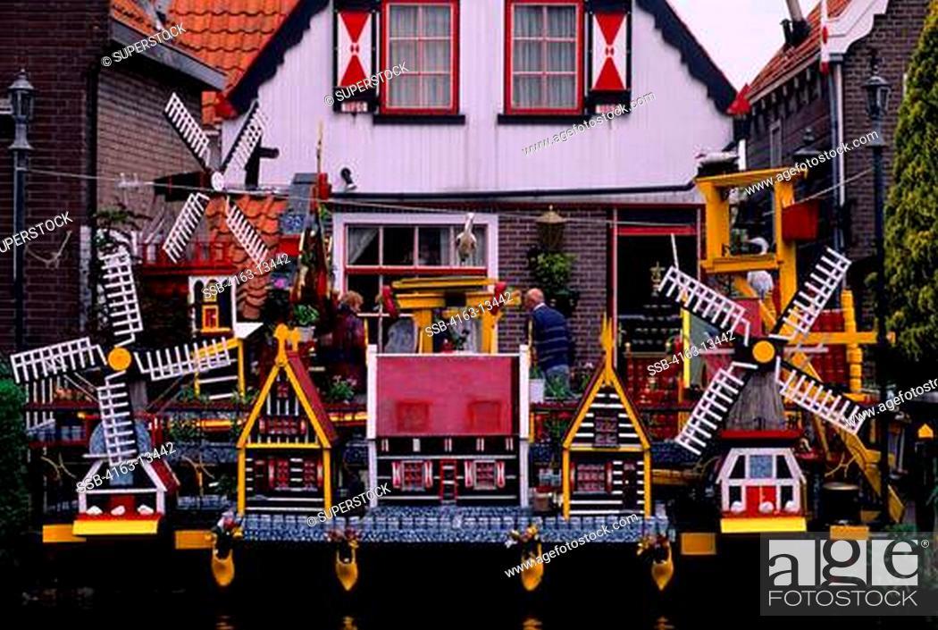 Stock Photo: NETHERLANDS, VOLENDAM, LOCAL HOUSE WITH MODEL WINDMILLS KITSCH.