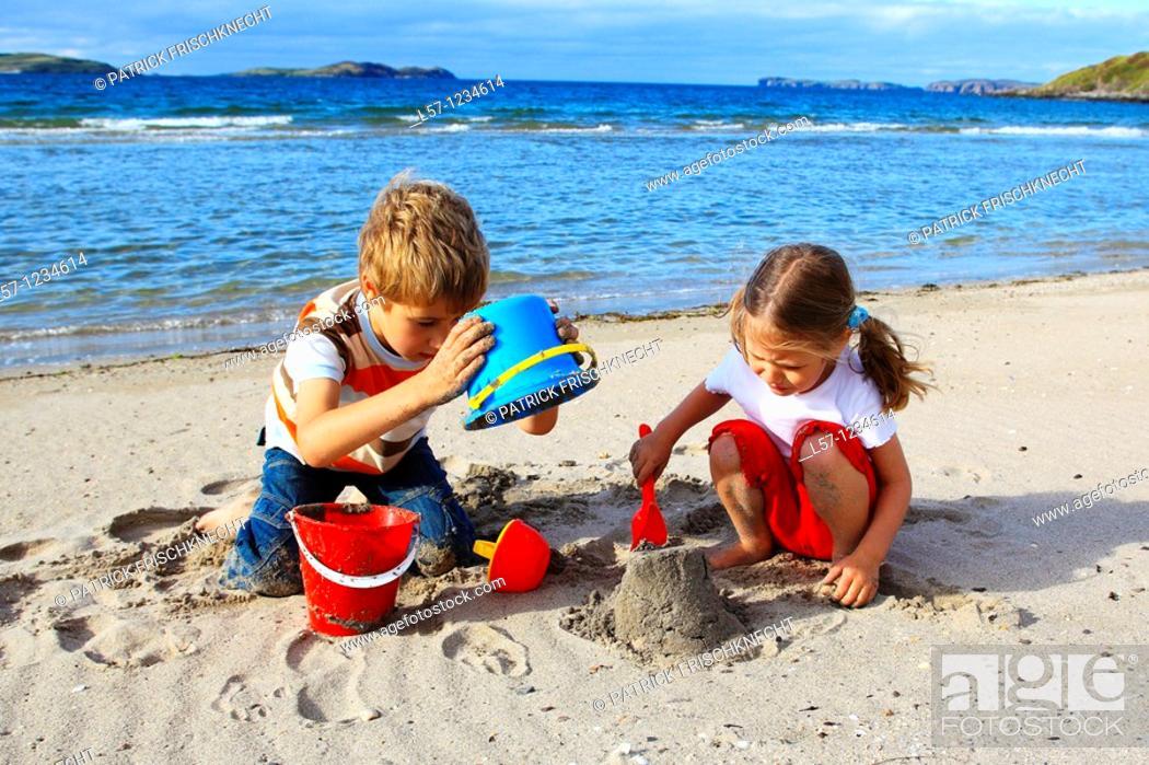 Stock Photo: children playing on sandy beach, Sutherland, Scotland.
