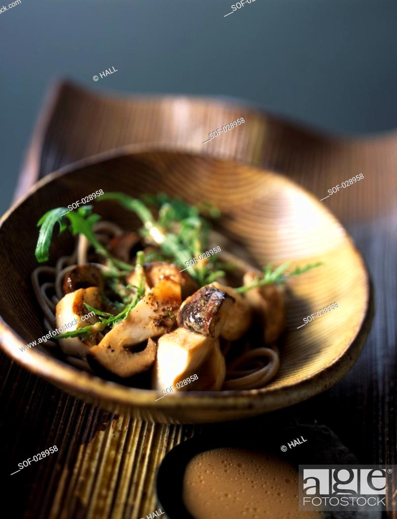 Stock Photo: Buckwheat pasta salad with ceps and sesame sauce.
