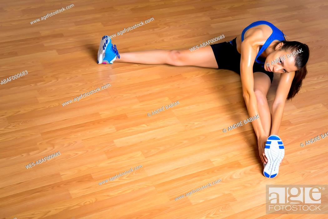 Stock Photo: Young woman stretching body.