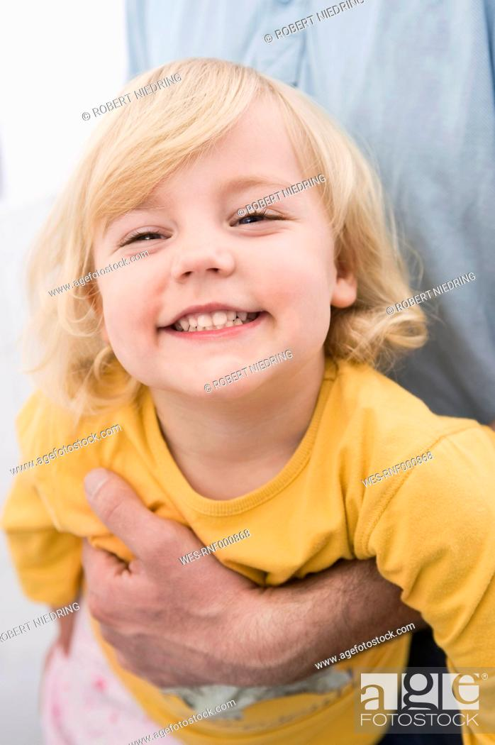 Stock Photo: Daughter having fun with father, smiling.