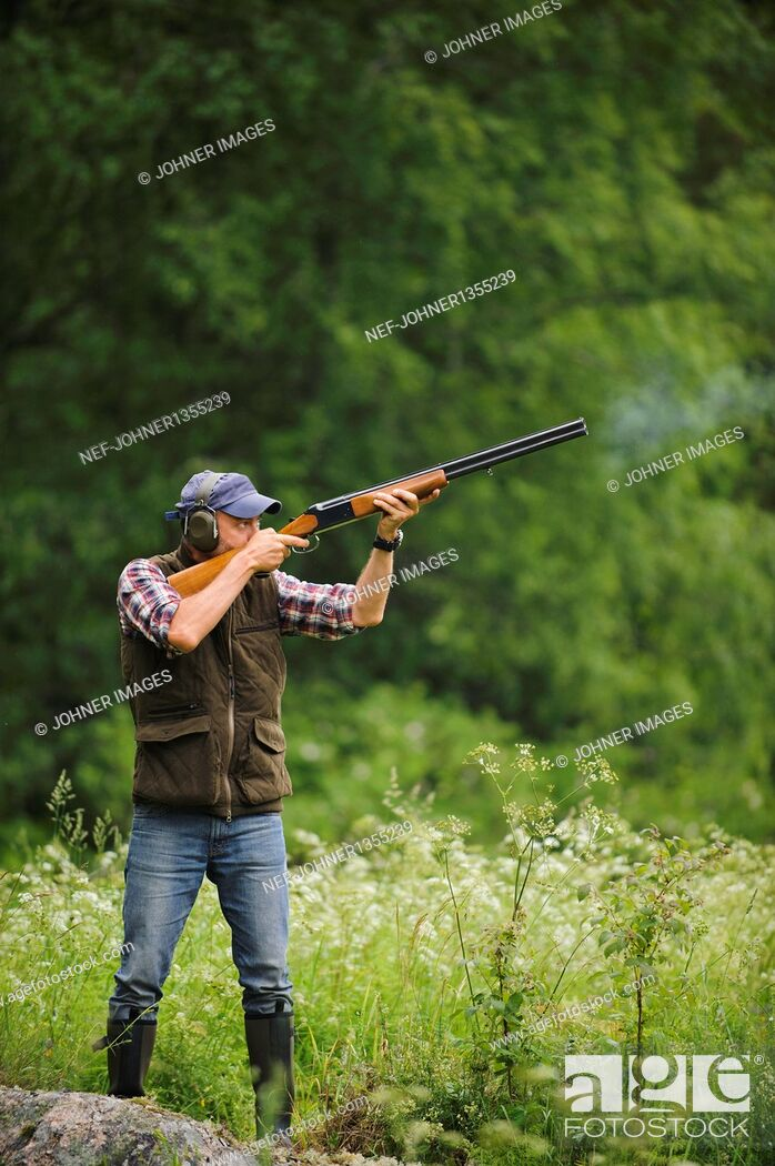 Stock Photo: Man hunting with rifle.
