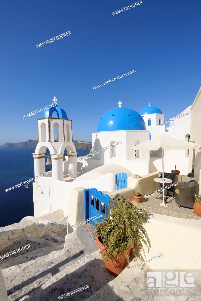 Stock Photo: Greece, View of whitewashed church and bell tower at Oia.