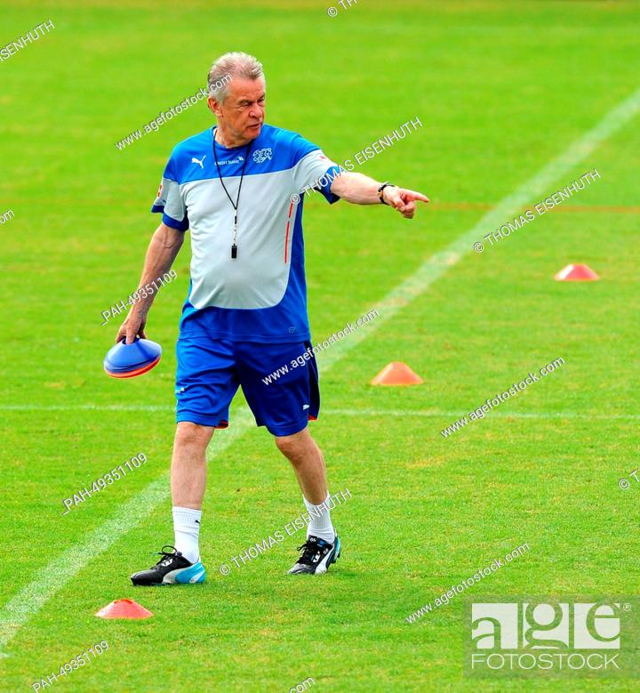 official photos 9d9ca 16310 Coach Ottmar Hitzfeld gestures during a training session of ...