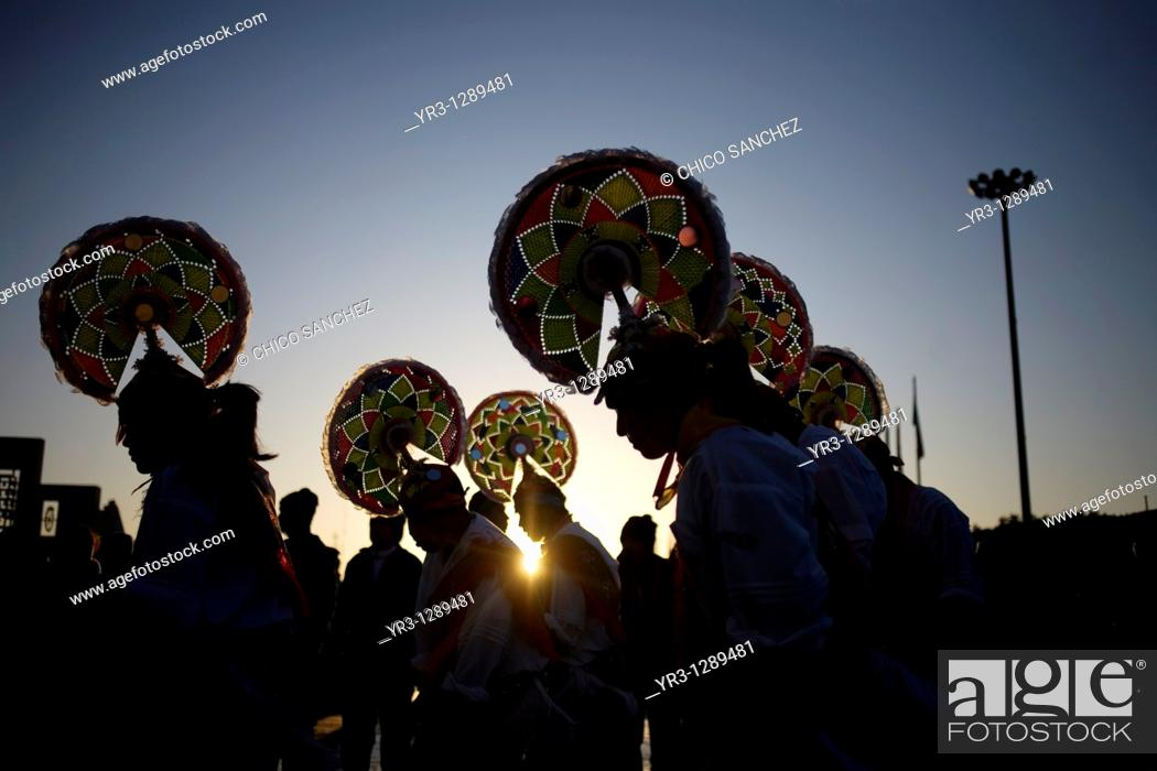 Stock Photo: Papantla dancers perform the turkey's dance outside the Our Lady of Guadalupe Basilica in Mexico City. Hundreds of thousands of Mexican pilgrims converged on.