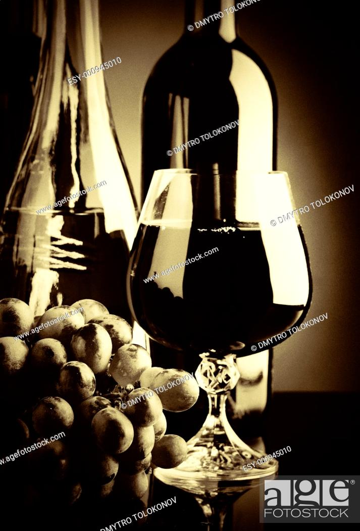 Stock Photo: Old wine  Retro still life with wine bottles and goblet.