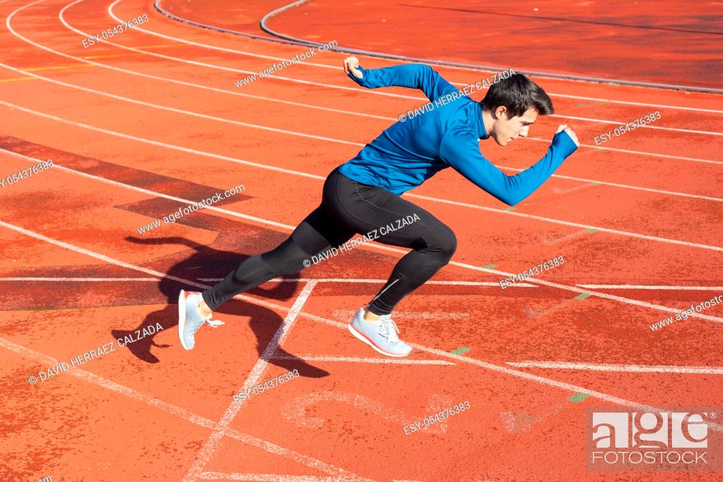 Stock Photo: Runner starting his sprint on running track in a stadium .