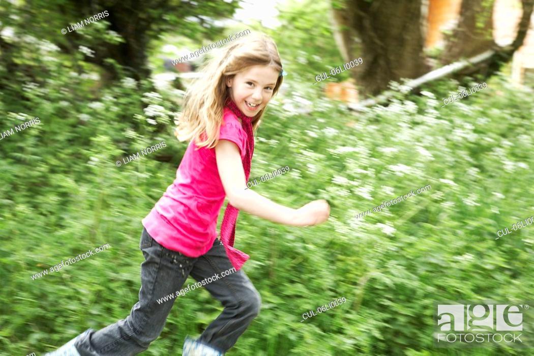 Stock Photo: Young girl running.