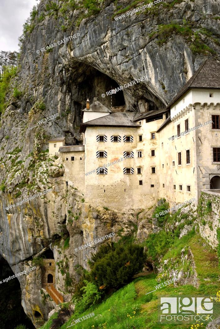 Stock Photo: Cliff cave entrances at Predjama Castle 1570 Renaissance fortress built into the mouth of a cliffside cave in Slovenia.