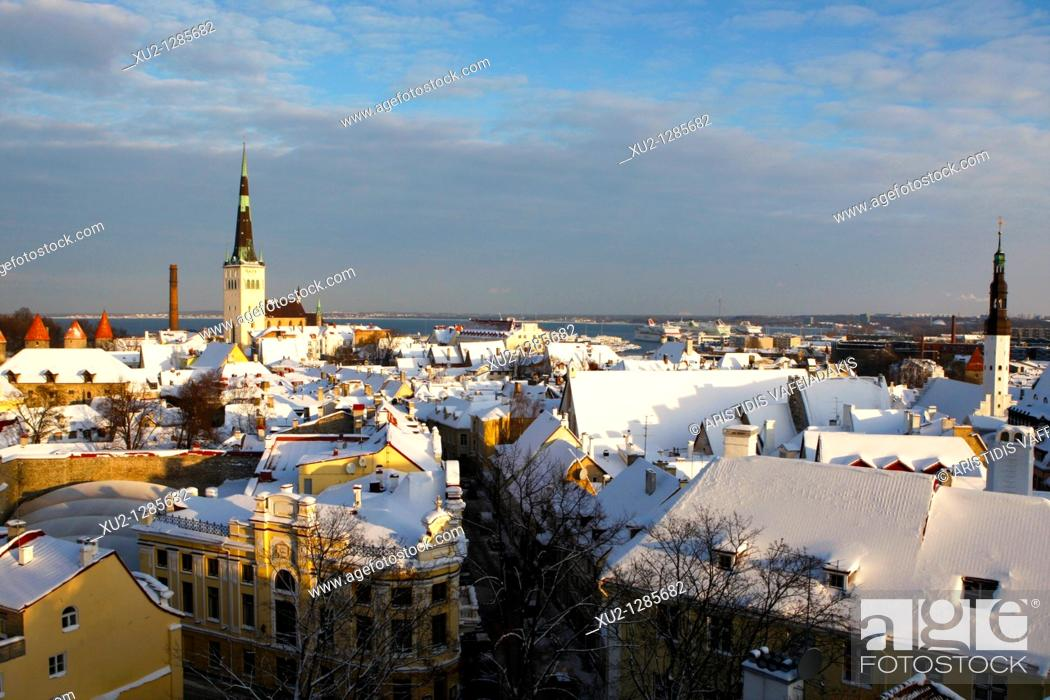 Stock Photo: Snowy roofs in Talin's old town with the port in the background  Christmas in Tallin Estonia.