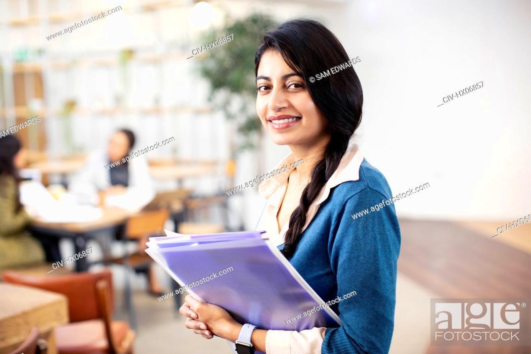 Stock Photo: Portrait confident, happy businesswoman in office.