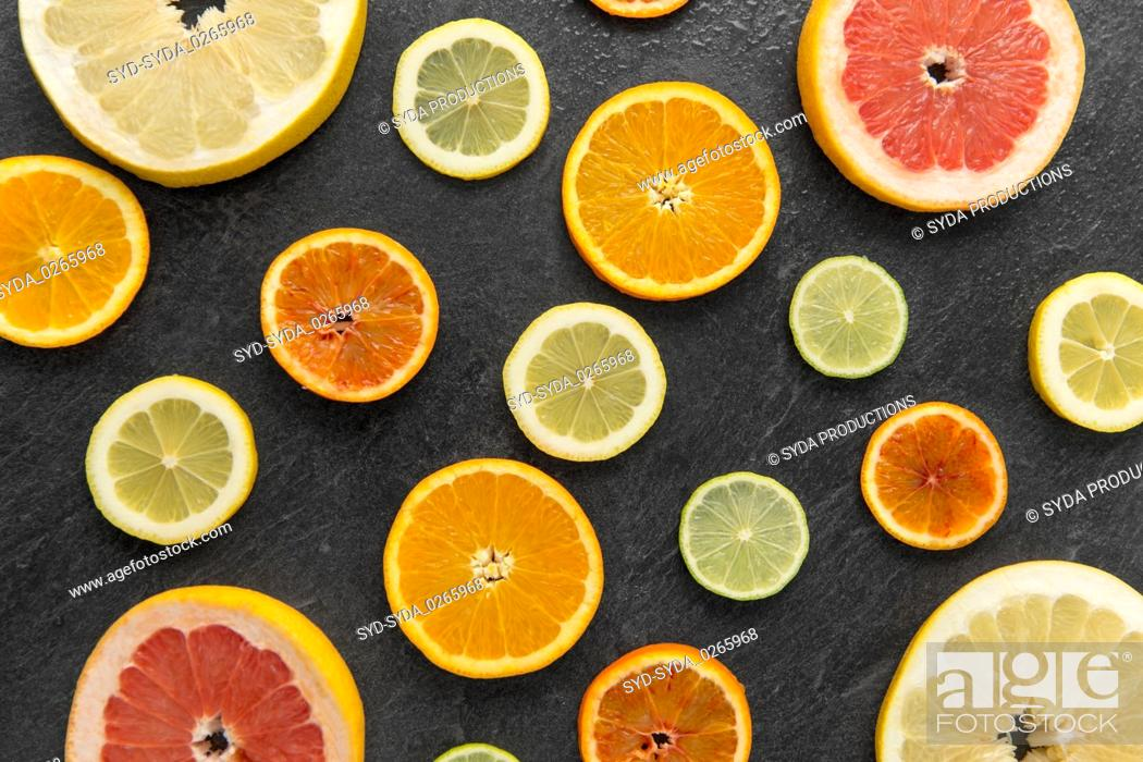Stock Photo: close up of different citrus fruit slices.