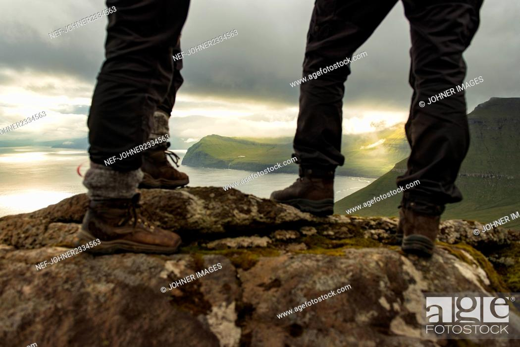 Stock Photo: Hikers standing on rocks, low section.