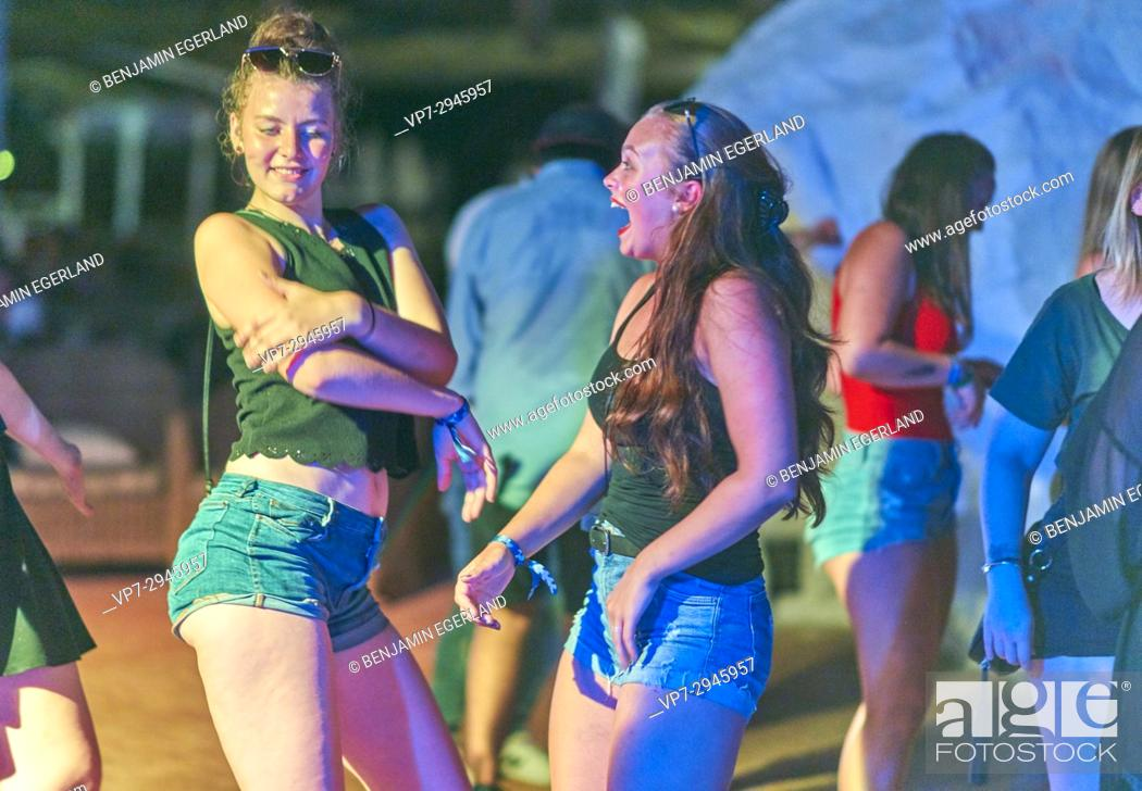 Stock Photo: happy girls dancing at summer party at music festival. German ethnicity. At holiday destination Hersonissos, Crete, Greece.