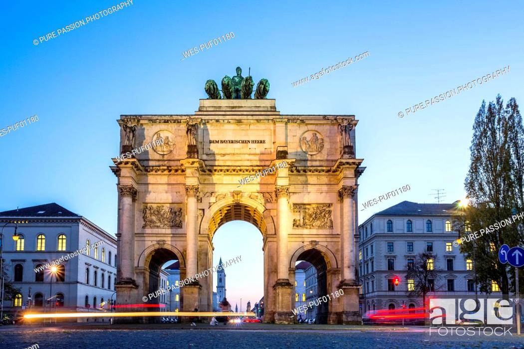 Stock Photo: Germany, Bavaria, Munich, North facade of Victory Gate, view to Ludwigstraße, blue hour.