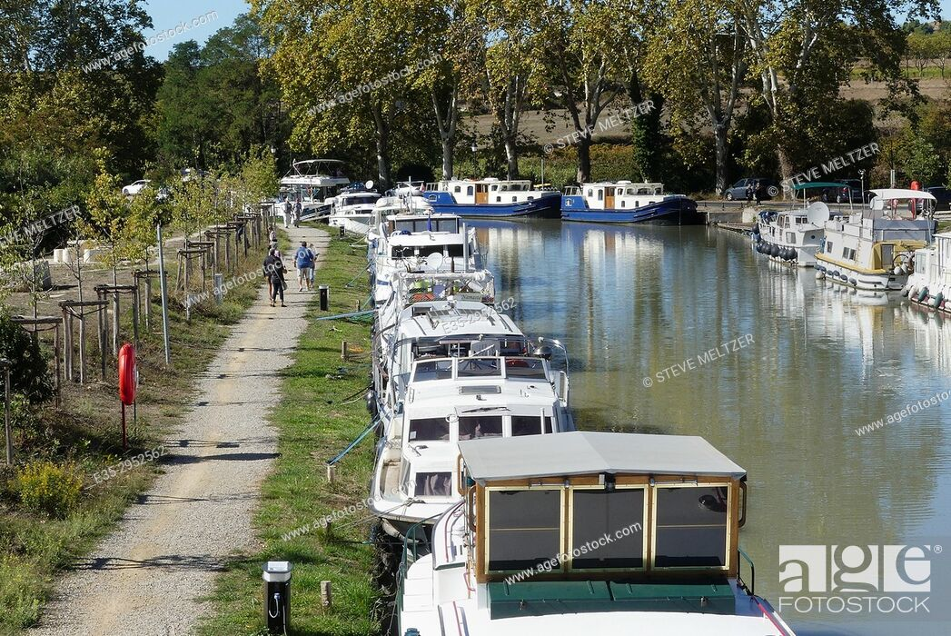 Stock Photo: Pedestrian path along the Canal du Midi at Capestang, France.