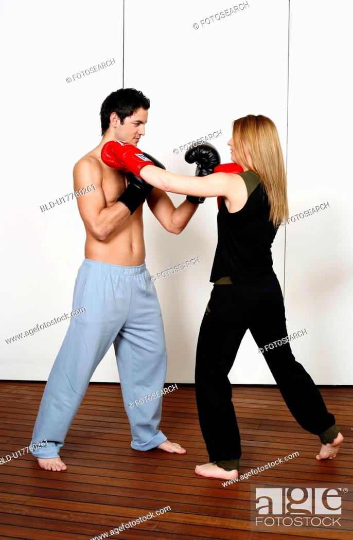 Stock Photo: Straight left-hand punch of Active Tae Bo and inside block.