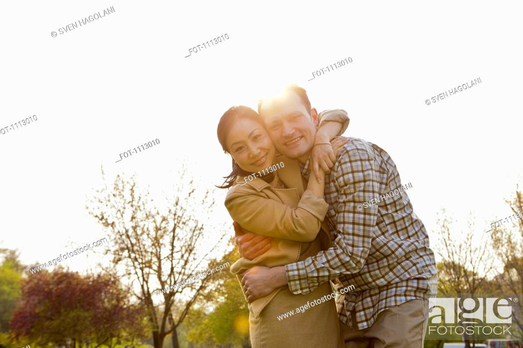 Stock Photo: A couple embracing outdoors.