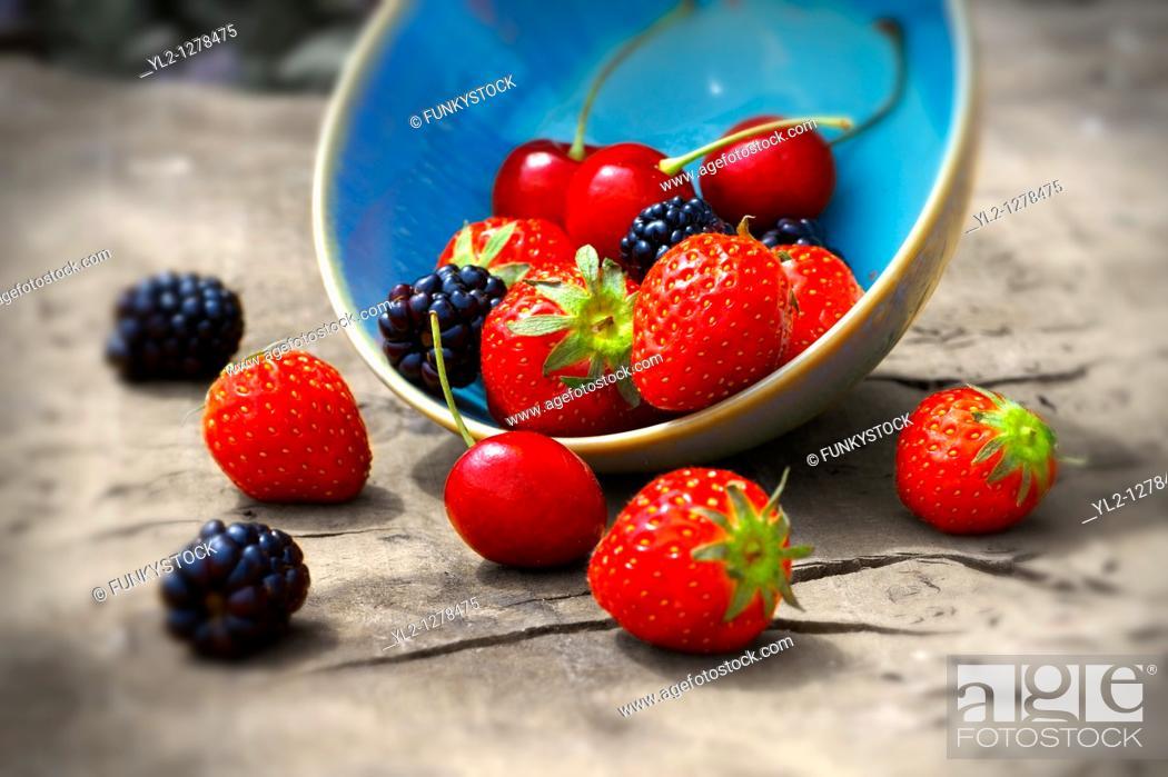 Stock Photo: mixed fresh summer fruits - strawberry, blackberry, cherry.