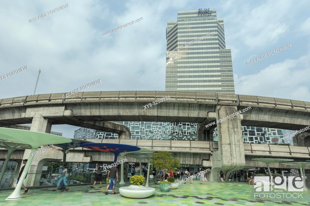 Stock Photo: View of the skytrain viaduc and the walkway near Siam Discorery Center, Bangkok; Thailand.