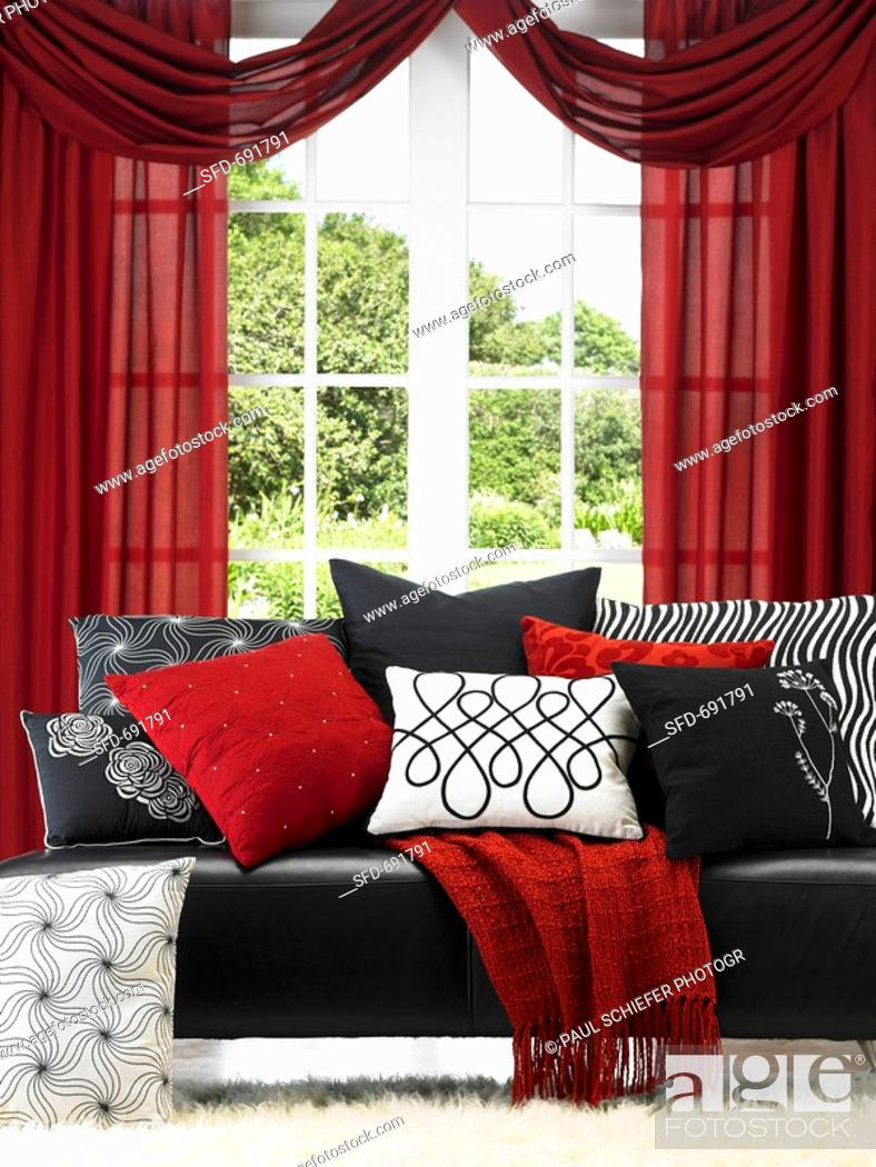 Black Leather Sofa With Red Black And White Accent Pillows