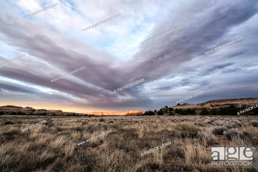 Stock Photo: Clouds over desert in Moab, Utah, United States.