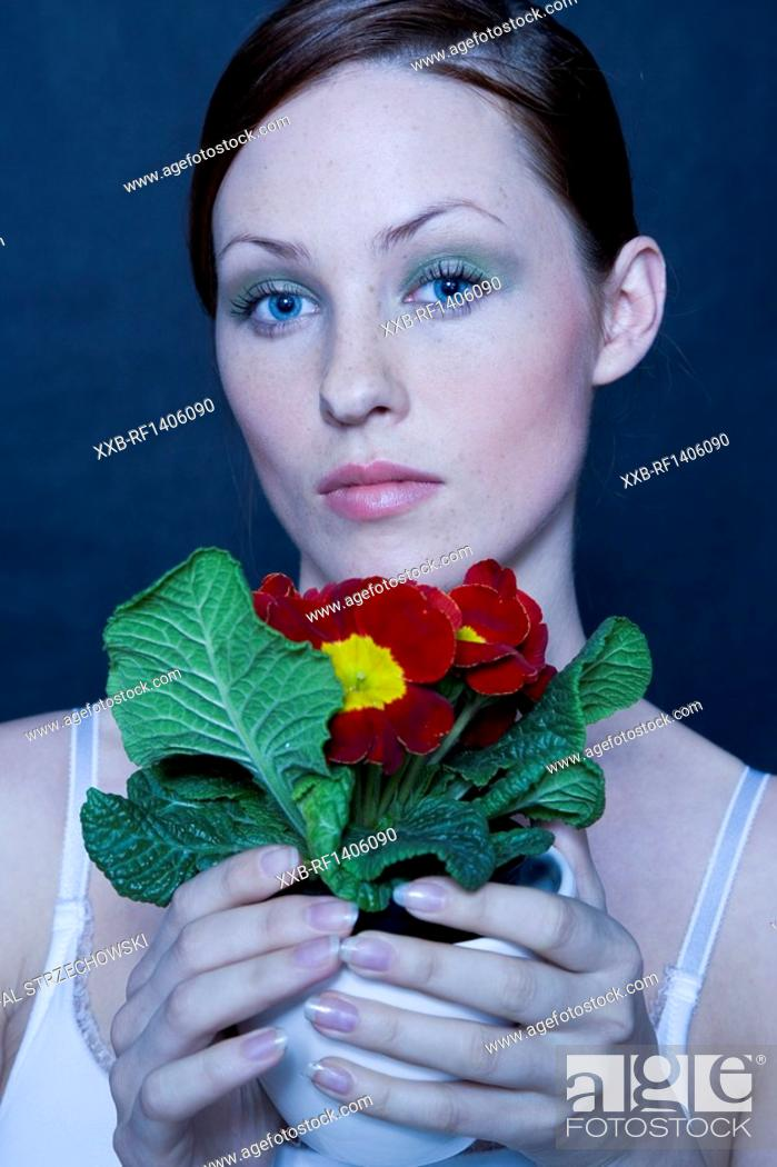 Stock Photo: beauty woman with potted primula.