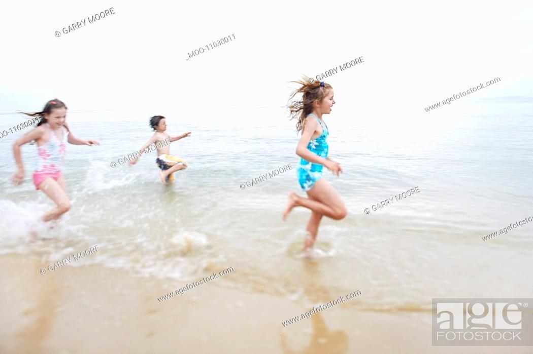 Stock Photo: Children running in surf.