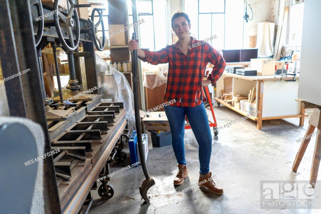 Stock Photo: Portrait of confident craftswoman in her workshop.