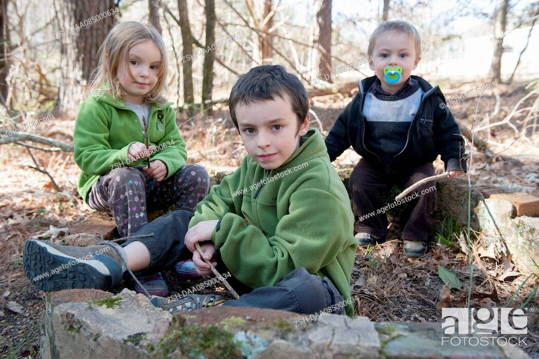 Stock Photo: Children playing in woods.