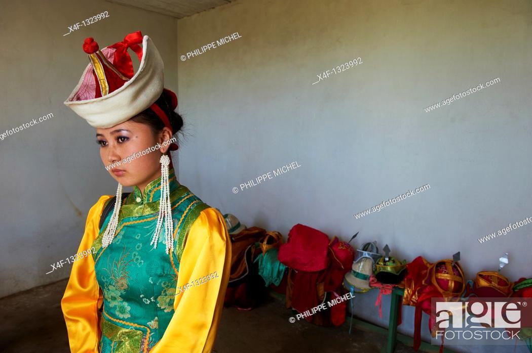 Stock Photo: Mongolia, Arkhangai province, Bayartsetseg, 18, take part at the Naadam festival.