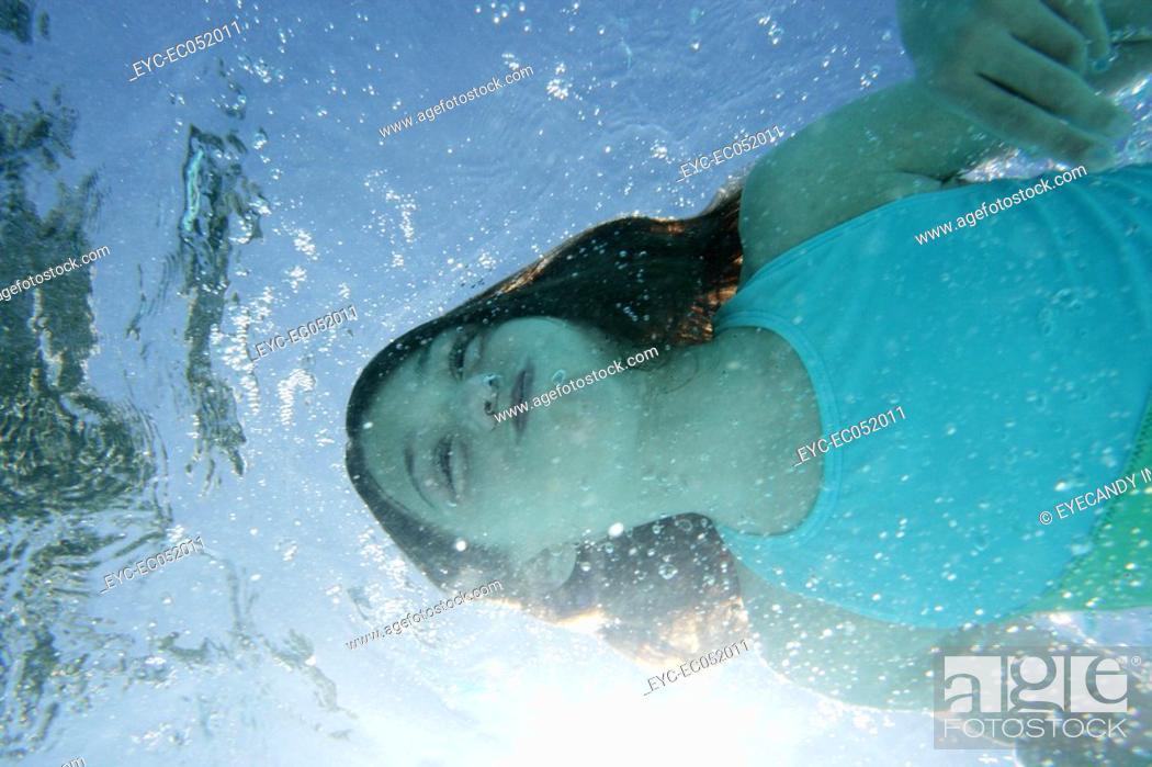 Stock Photo: Little girl swimming underwater.