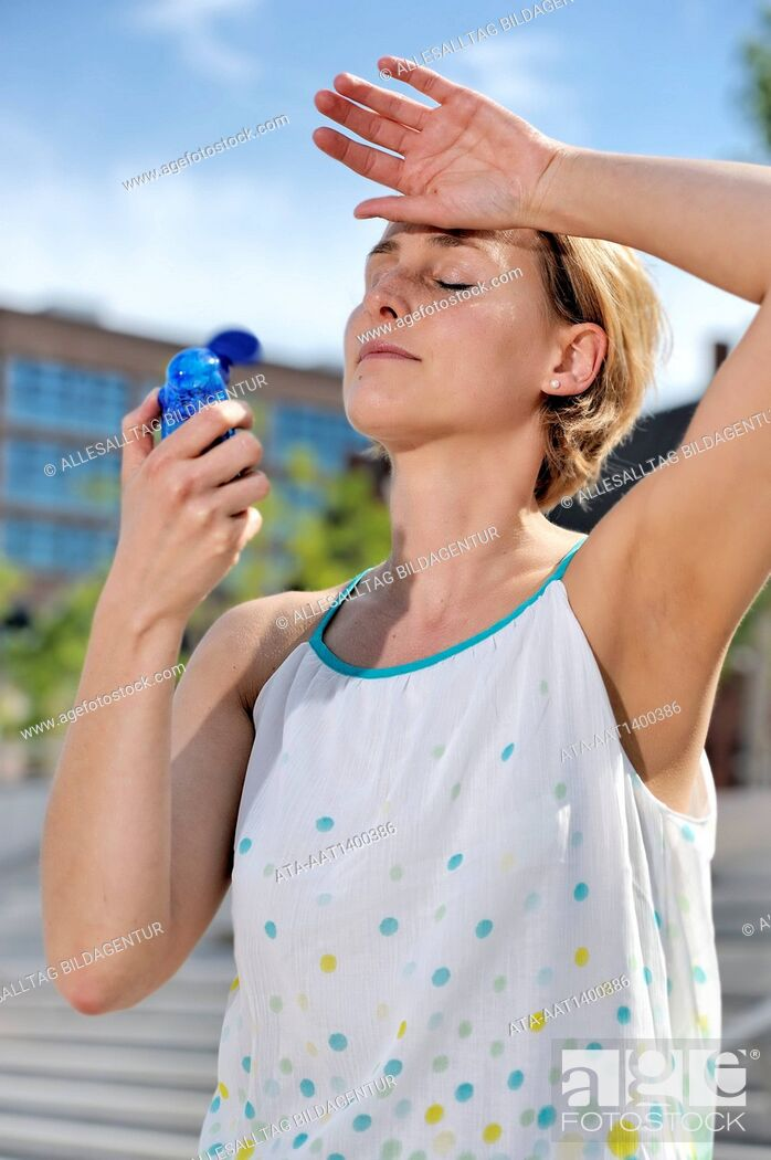 Stock Photo: Woman sweating in the summer.