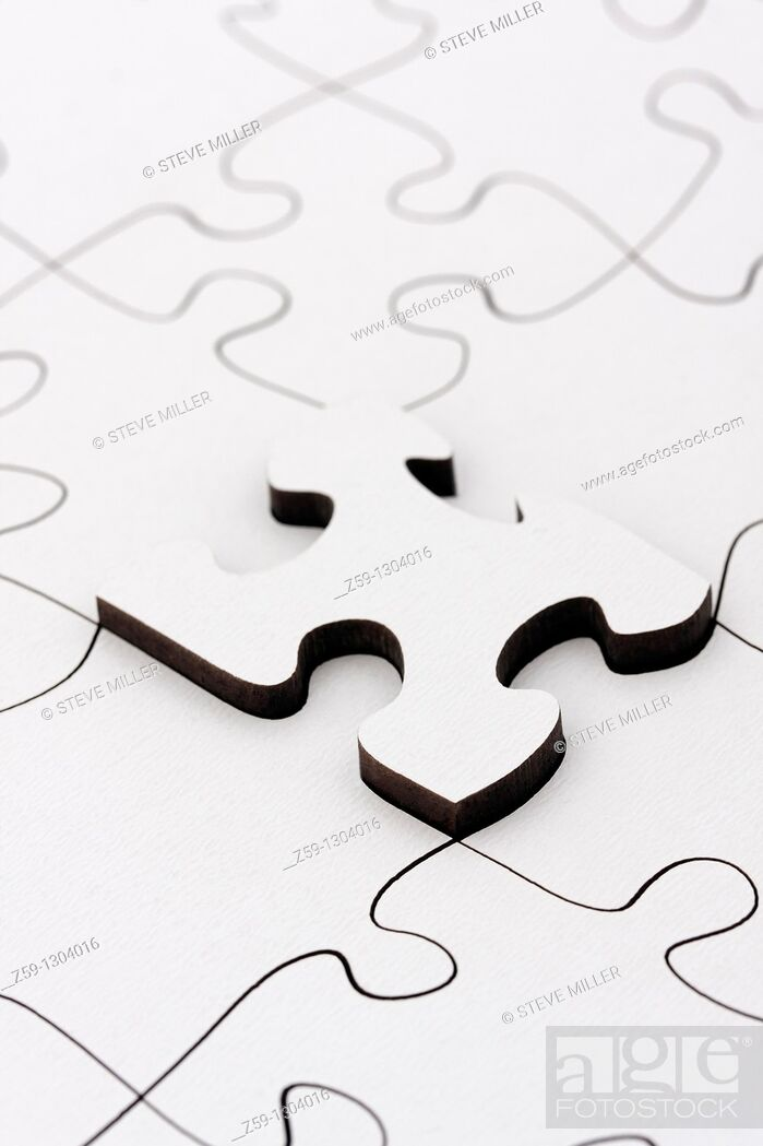 Stock Photo: parts of jigsaw - symbolism for existential orientation resp  education.