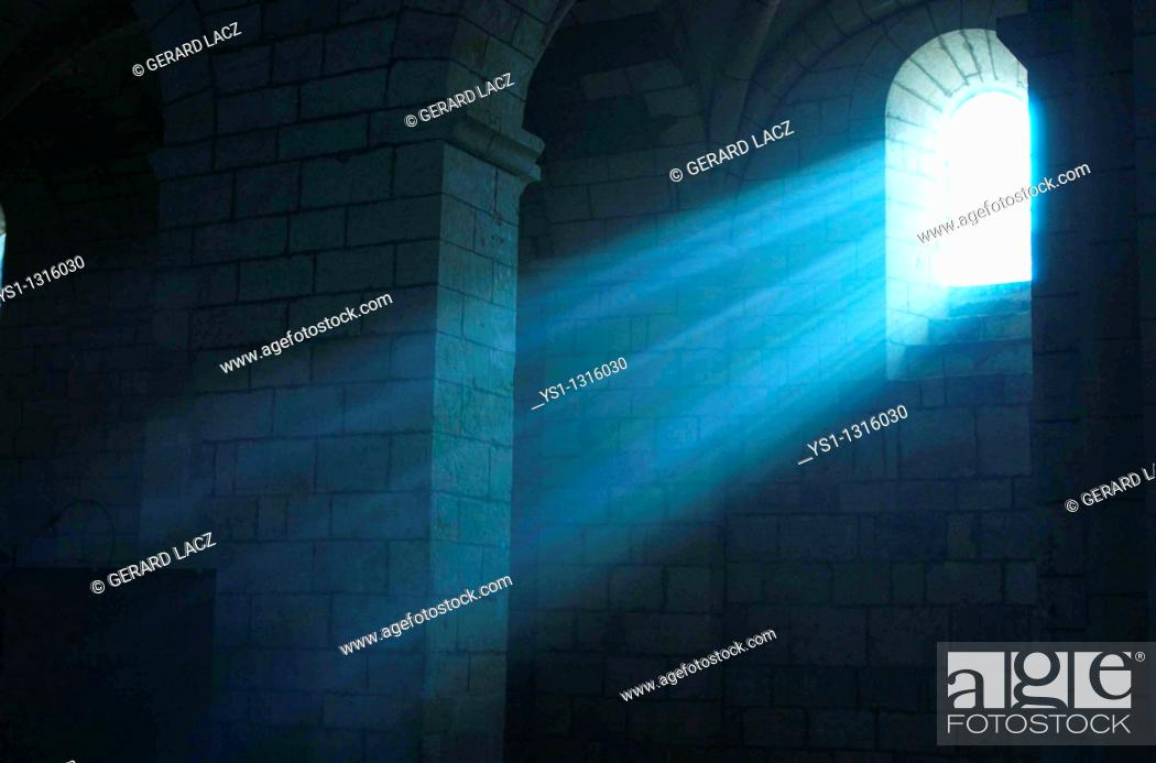 Stock Photo: RAYS OF SUNLIGHT SHINING THROUGH WINDOW, CHURCH IN DROME, SOUTH EST OF FRANCE.