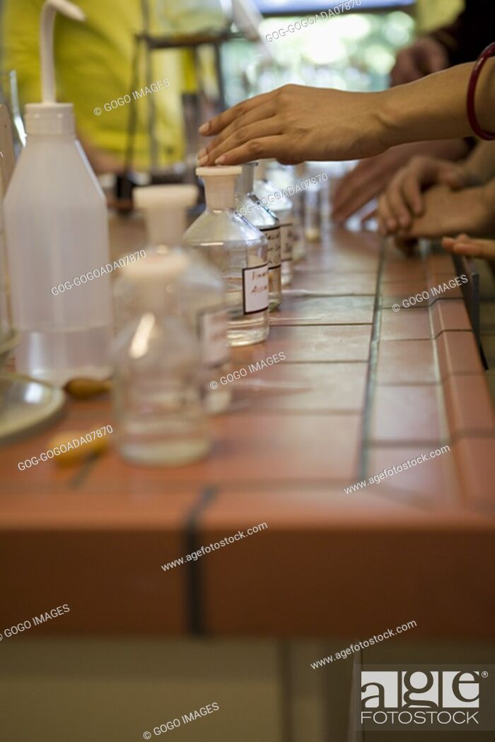 Stock Photo: Jars of chemicals on desk.
