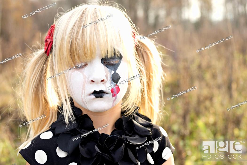 Stock Photo: Portrait of girl with painted face.