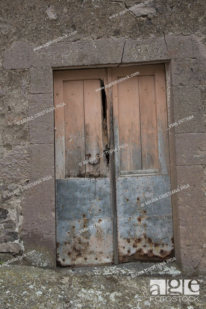 Stock Photo: Old wooden door in the small village of Bortigali, Sardinia, Italy.