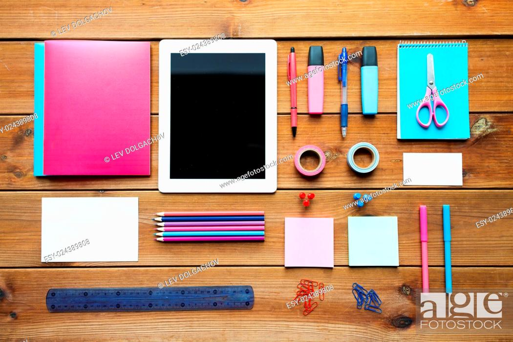 Stock Photo: education, school supplies, art, creativity and object concept - close up of stationery and tablet pc computer on wooden table.