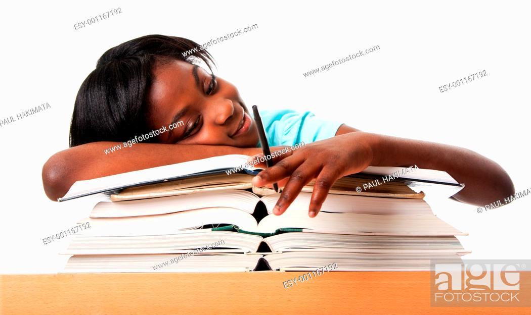 Stock Photo: Student tired of doing homework studying with pen laying unmotivated on stack open books, isolated.