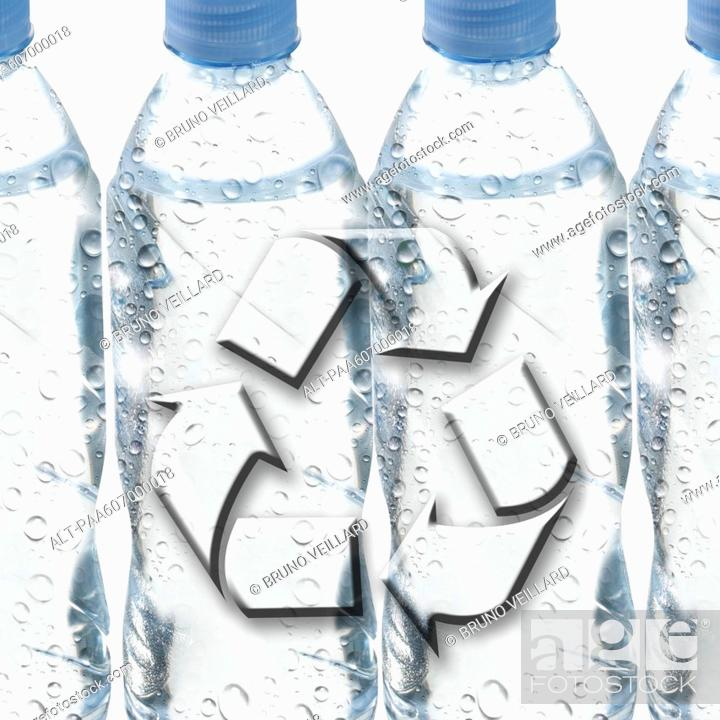 Stock Photo: Plastic water bottles and recycling symbol.