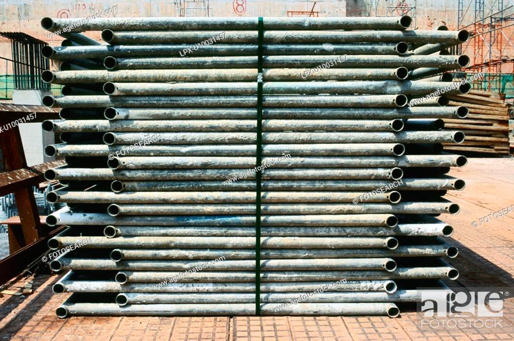 Stock Photo: Stack of scaffolding tubes.