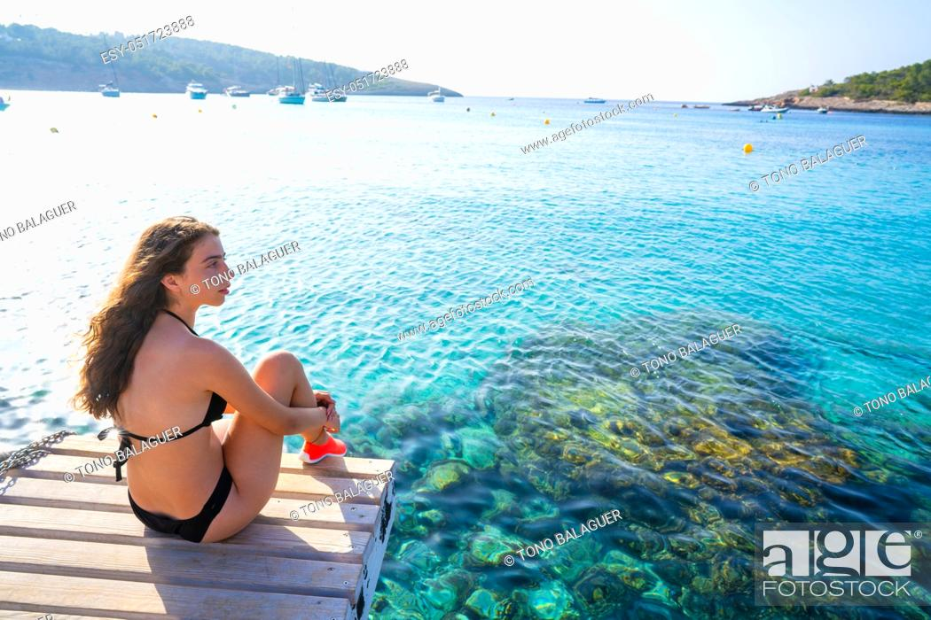 Stock Photo: Ibiza bikini girl relaxed at Portinatx beach pier in Balearic Islands.