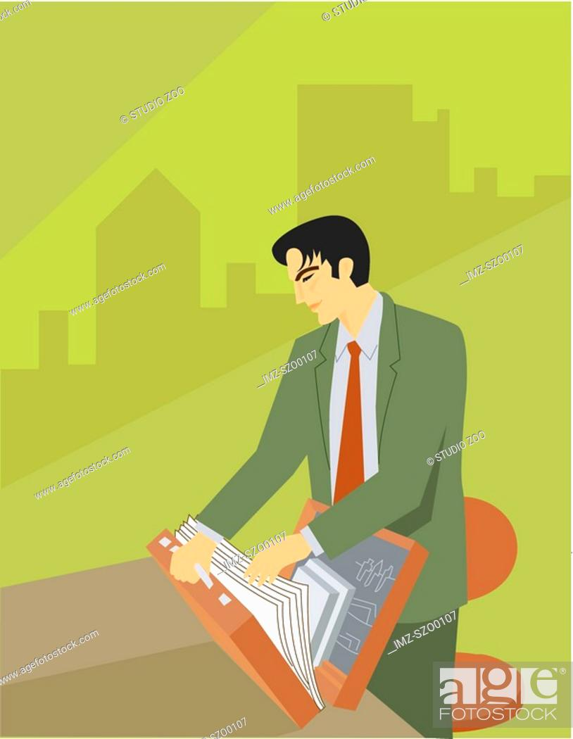 Stock Photo: A businessman looking through the documents in his briefcase.
